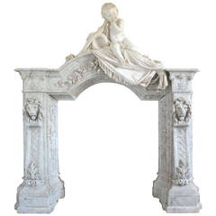 Carrara Marble Fireplace Surmounted by a Marble Putto, 19th Century