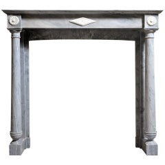 French Directoire period Bleu Turquin marble fireplace. Late 18th Century