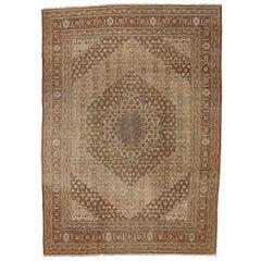 Haji Khalili Antique Persian Tabriz Rug with Warm, Industrial Style
