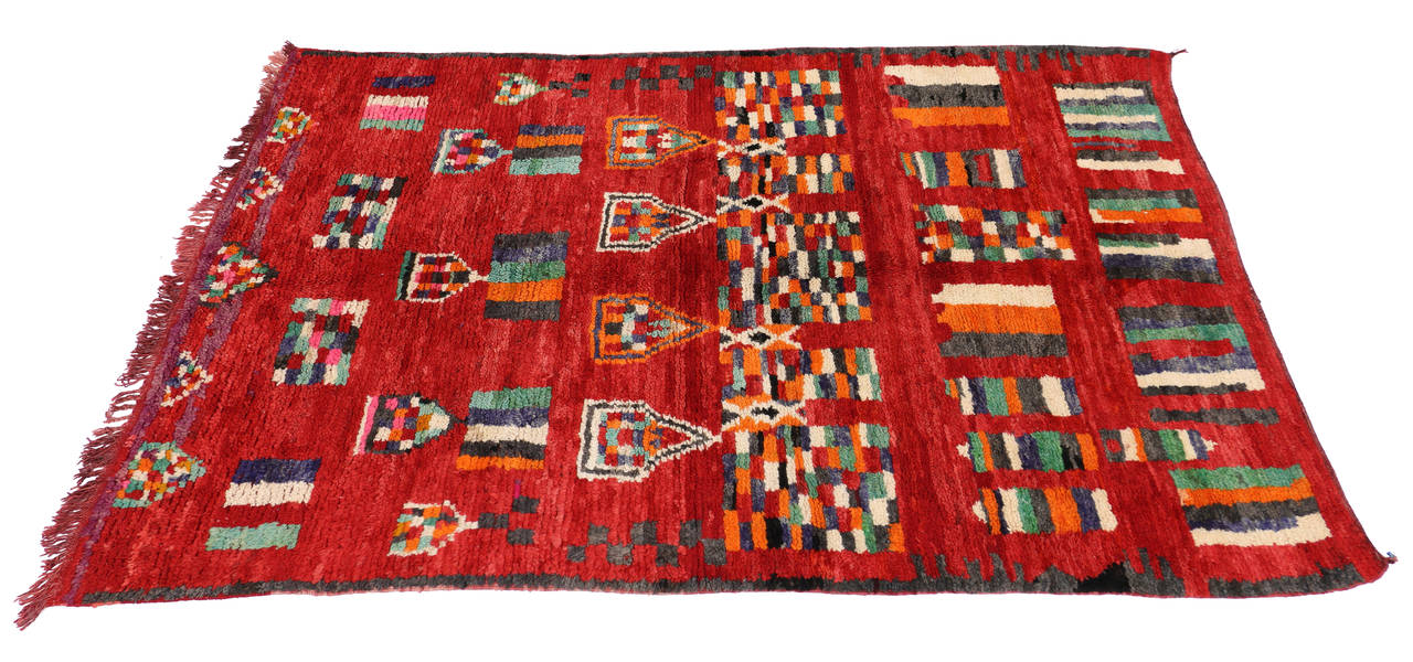 74789 Animated with Berber tribe motifs and secondary protection symbols, this hand-knotted wool vintage Berber red Moroccan rug offers many meanings that are represented through its geometric shapes. A series of pentagons possibly representing