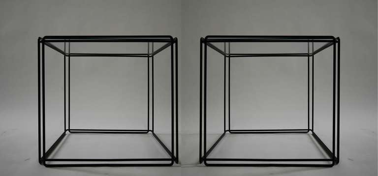 Pair of 'ISOCELE' tables by artist Max Sauze, circa 1970s, France. Constructed of black enameled steel and glass.