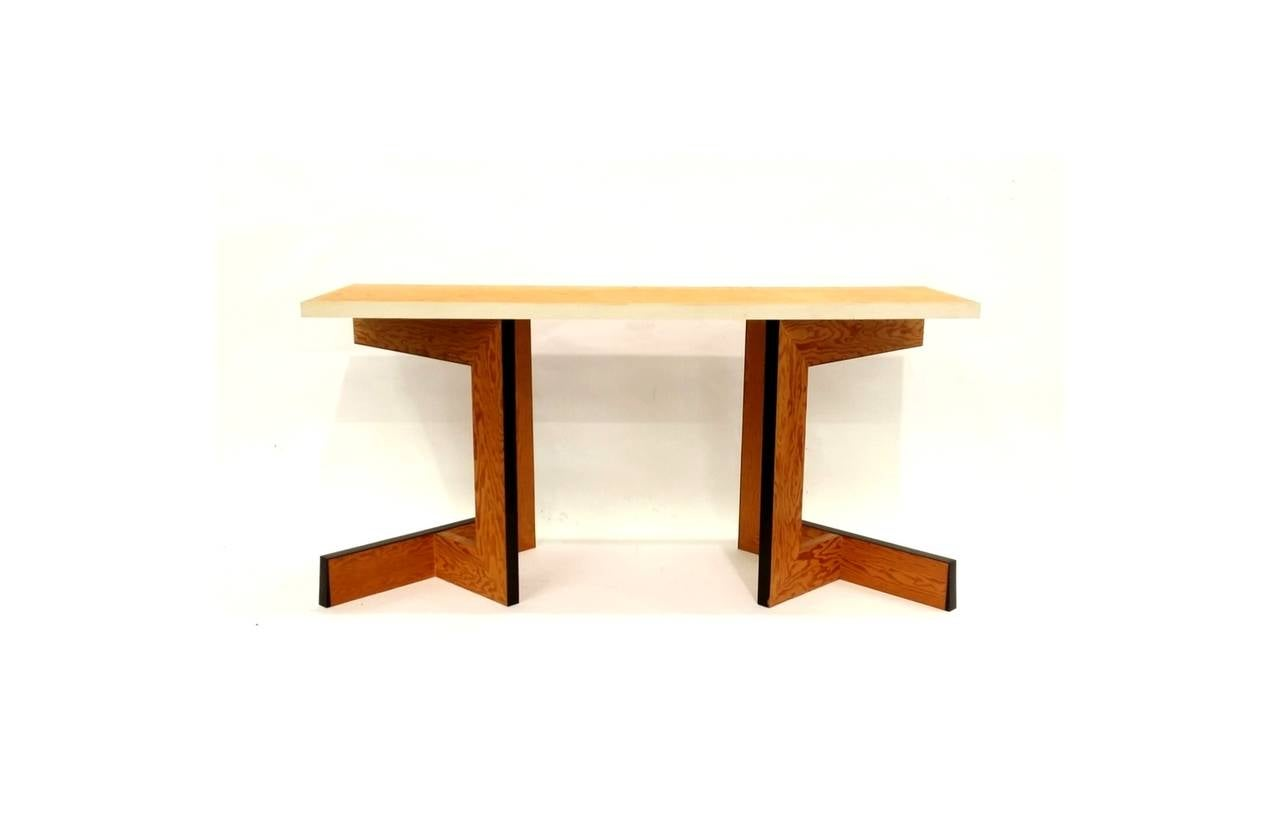 Constructivist console table designed by Eric Freeman. Table can also serve as a writing desk. An ingenious design constructed of plywood and ebony, with a natural white rubber edge to top. As illustrated in the pictures, the table can be used with