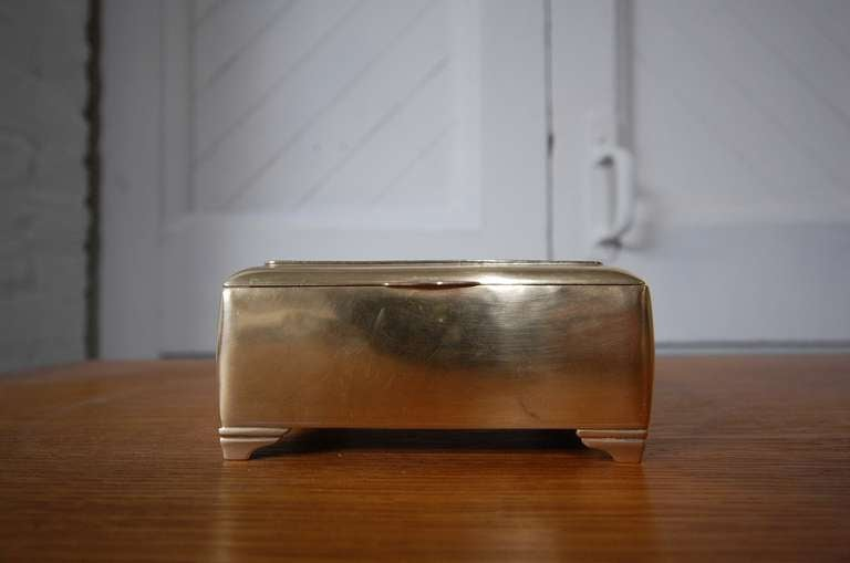 Mahogany lined Brass Box by Just Andersen. Denmark, circa 1930's. A very nice, early example of Andersen's work.  LUNA offers free delivery on most of our items within the Long Island / Greater NYC, northern New Jersey, Connecticut and