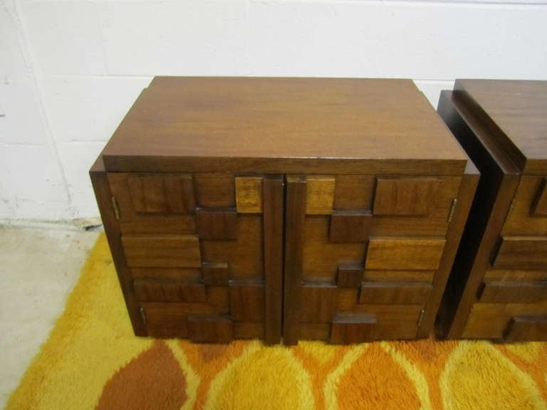 Handsome pair of Paul Evans inspired chunky walnut mosaic night stands made by Lane.  They are well constructed and in very nice condition.The doors open to reveal a nice open space with one fixed shelf.  I do have more pieces from this same