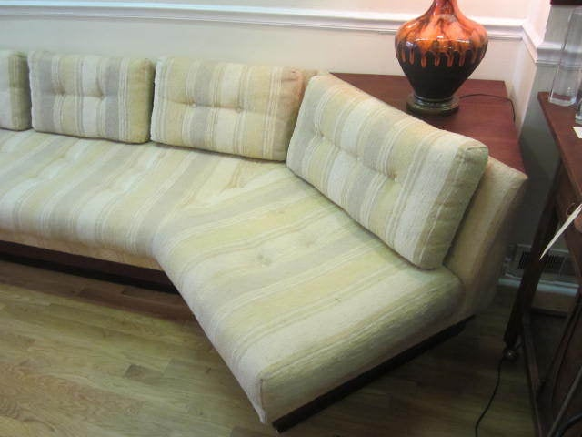 GORGEOUS ADRIAN PEARSALL BOOMERANG PLATFORM SOFA WITH BUILT IN TRIANGULAR SIDE TABLE.  THIS PIECE HAS IT'S ORIGINAL NUBBY TEXTURED FABRIC IN NICE VINTAGE CONDITION.  THE STRIPED VINTAGE FABRIC IS A LIGHT YELLOW WITH BEIGE AND CREAM.  THE WALNUT AND