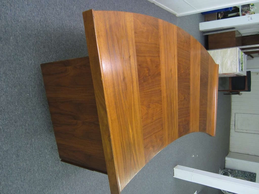 HARVEY PROBBER CURVED TOP EXECUTIVE DESK.  THIS DESK HAS ALL THE BELLS AND WHISTLED WITH TWO PULL OUT WORK SPACES,FILING DRAWERS AND LOCKS.   THE THICK CURVED WALNUT WOOD TOP END WITH HUGE RAISED LIPS. PLACE THIS MAD MAN STYLE DESK IN THE MIDDLE OR