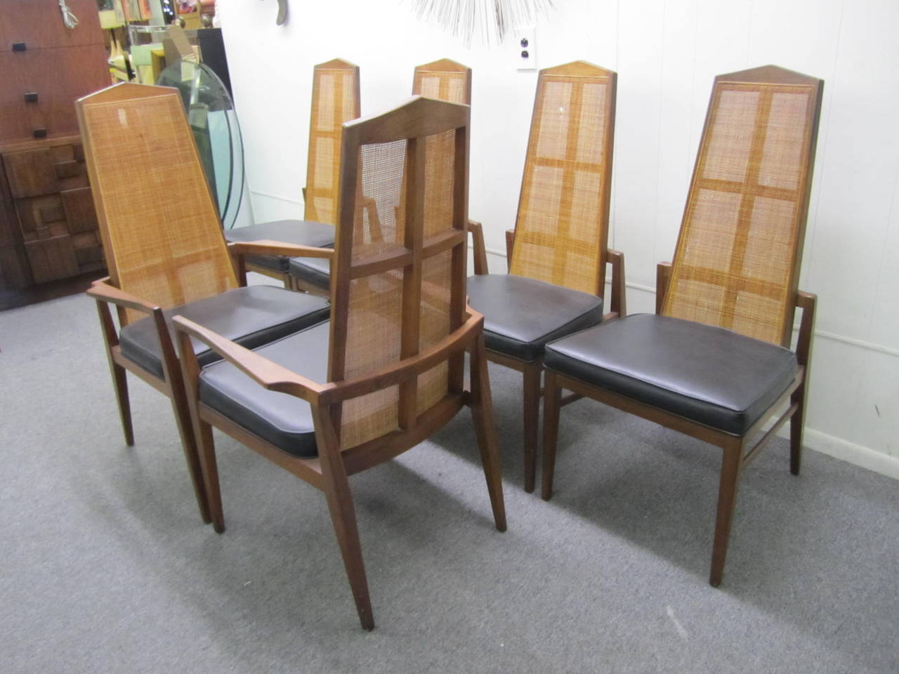 Mid Century Modern Walnut Dining Set by Foster McDavid. Founded in 1950 in Tampa, Florida- Foster McDavid's designs exude the stylings of the mad men era. These chairs look great with their original Probber style octagon dining table-see last photo