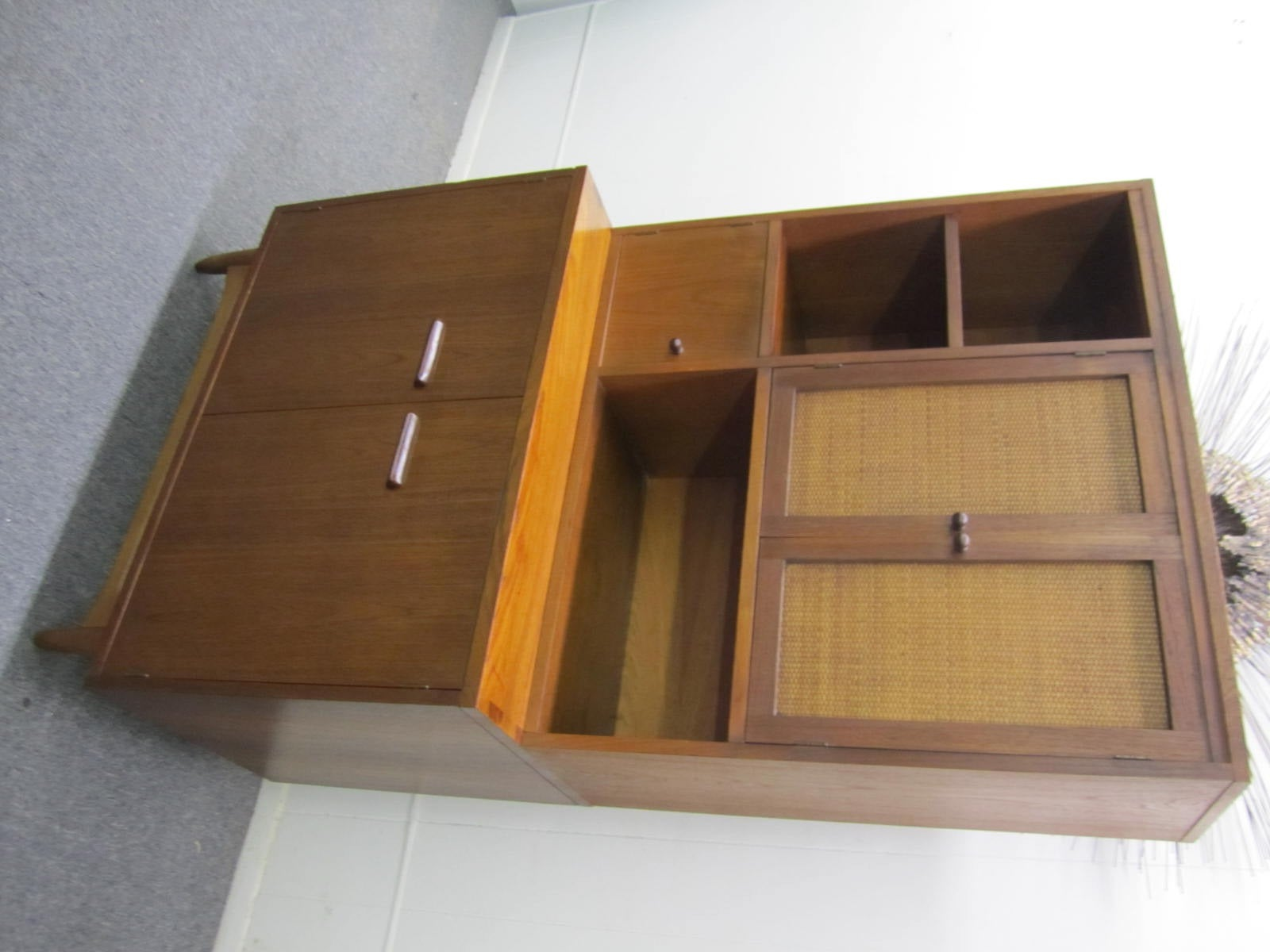 Rare 2 piece cabinet with separate hutch- part of the Acclaim series for Lane.  Great storage options for in the kitchen or any living space with tons of cubbies and one drawer.  We especially like the caned front doors on the removable hutch.  Put