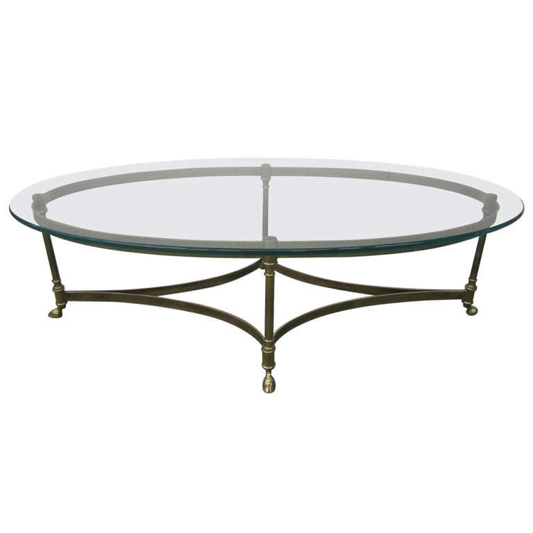 Brass and heavy glass oval hoof foot coffee table regency for Heavy glass coffee tables