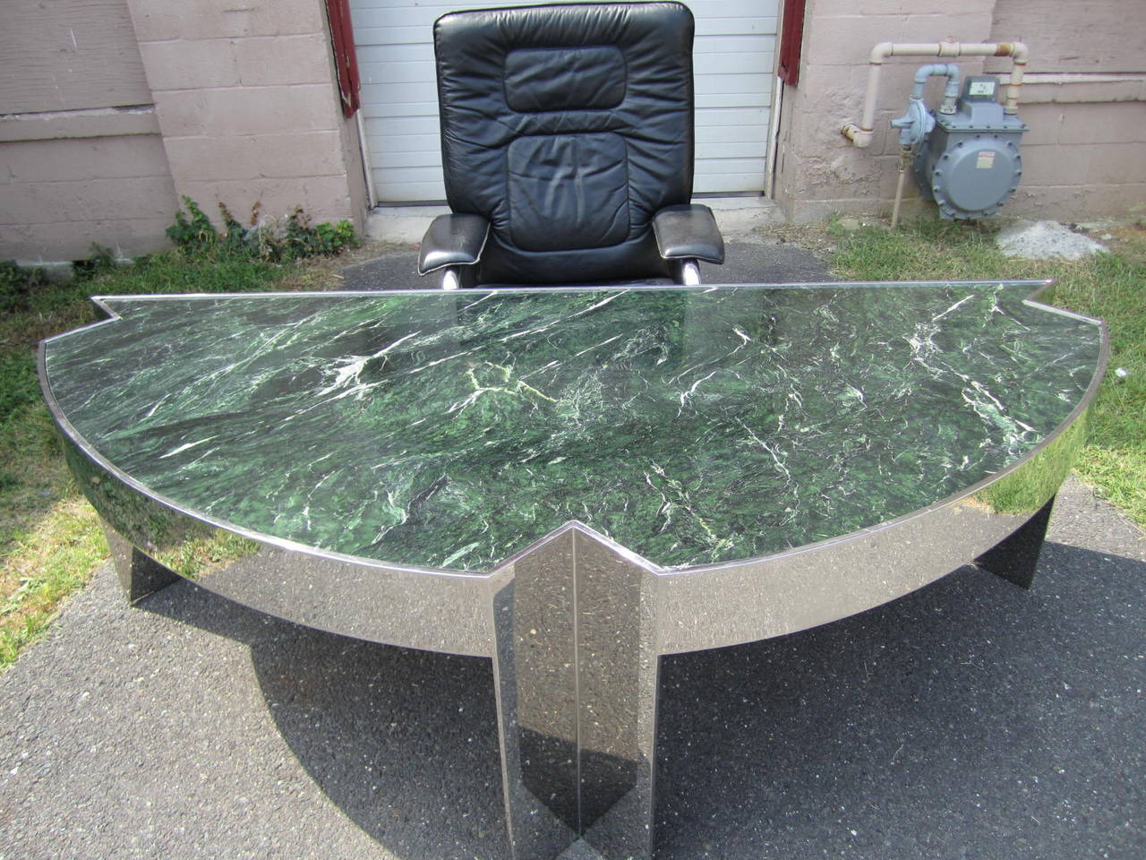 A vintage 1970s large 'Mezzaluna' desk designed by Leon Rosen for Pace Collection. Half-circle desk with a wide chromed steel frame and verde green marble-top. Magnificent in person this desk is sure to impress! We do have the matching rolling desk
