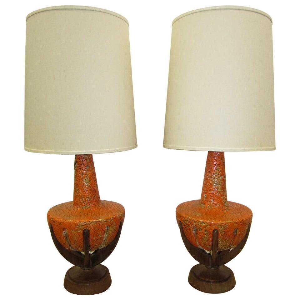 Amazing Pair of Thick Lava Glaze Orange Ceramic Lamps with Walnut Finger Bases