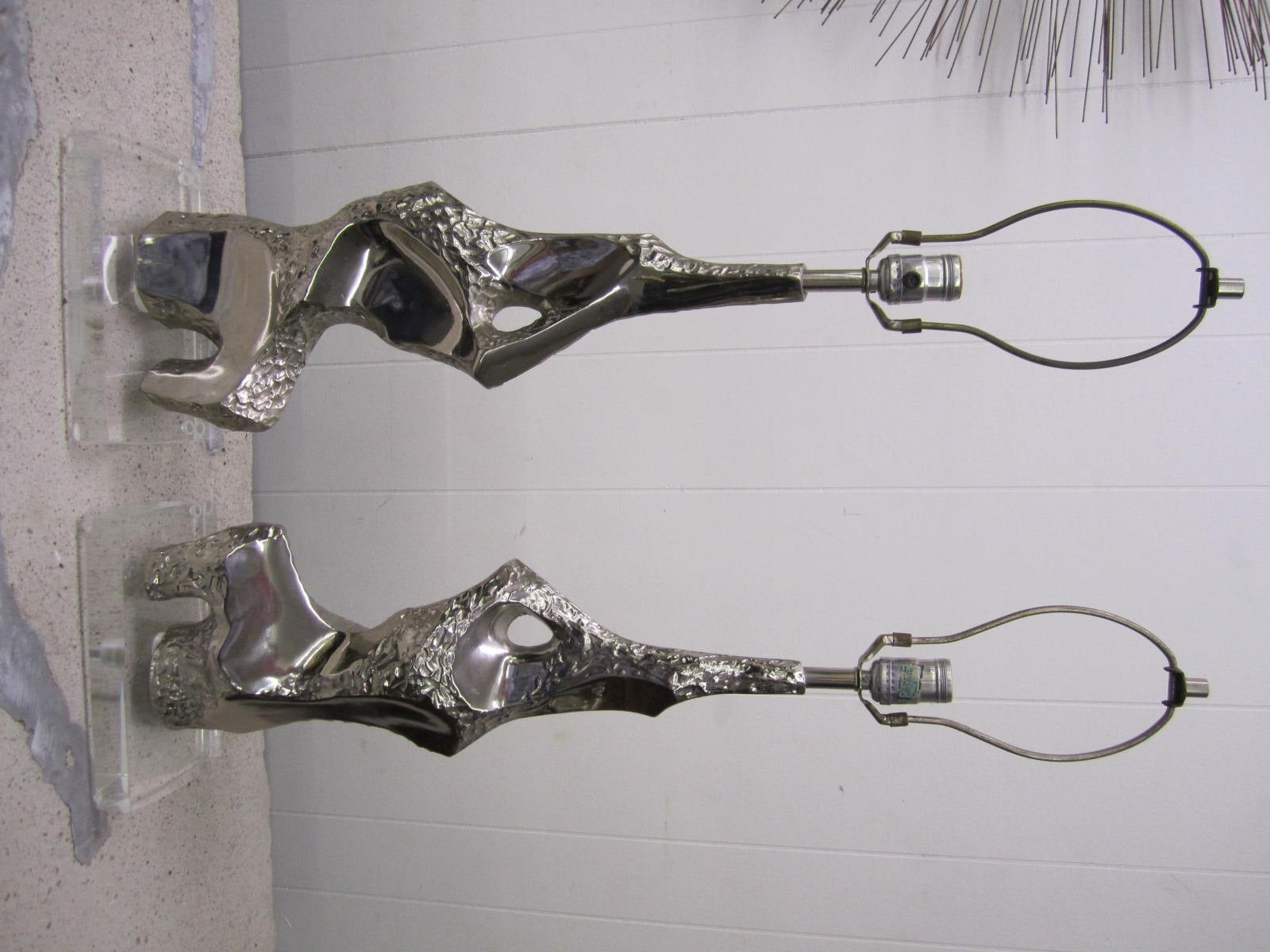 Outstanding pair of brutalist chrome and lucite torso Laurel Lamps.  The original black painted bases were replaced with these thick period lucite bases and look even better than they originally did.  I think you will agree that these lamps are even