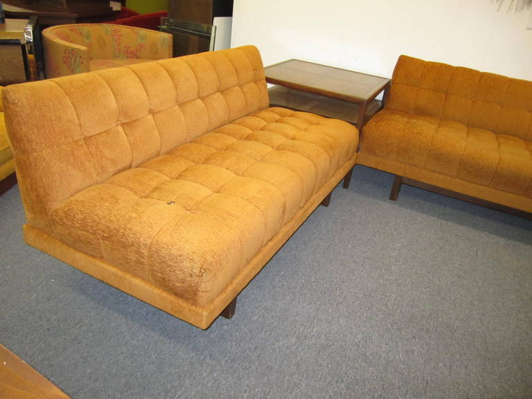 Stunning Harvey Probber style 2 piece sectional sofa.  Classic lines with box tufted cushions and chunky walnut base and legs-great looking used anywhere in the room.  We have used it with one of our Baker square 2 tiered side tables from the same