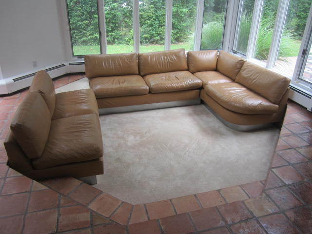 Outstanding Milo Baughman four-piece buckskin leather and chrome sectional sofa. Wow! This vintage leather sectional is sensational with two straight pieces, one chaise piece and one small triangular table. The chrome clad plinth base encases the