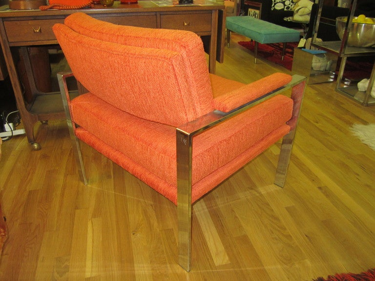 Stunning Milo Baughman large-scale chrome lounge chair. We have restored this piece with new foam and high end orange woven fabric. Just gorgeous in person.