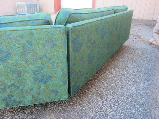 Wonderful 2 piece signed Harvey Probber sectional sofa. This piece is in vintage condition with it's original floral tapesty fabric. The fabric does show some wear to the corners but is very presentable. The cushions are still full of life and are