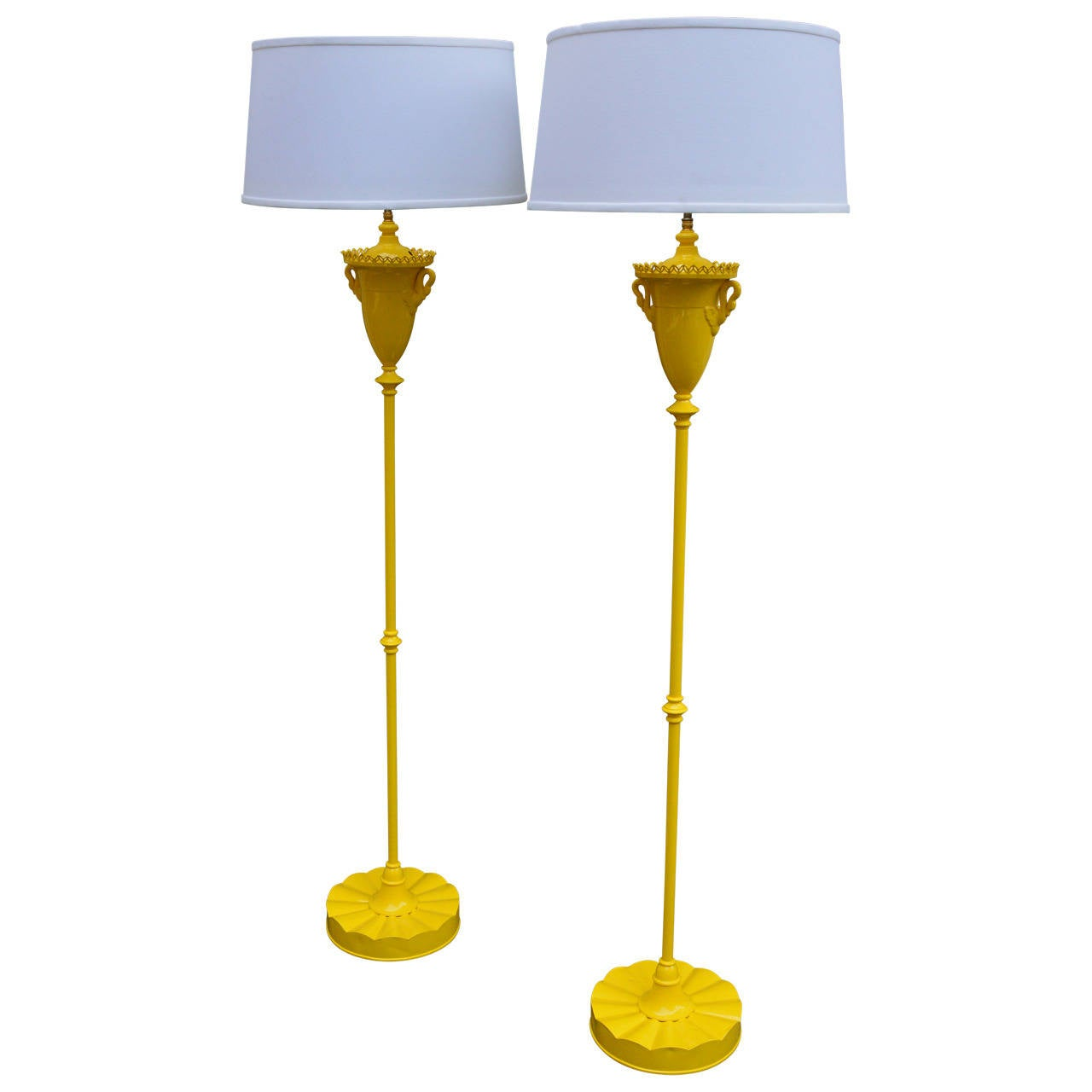 Early 20th century oil lamps electrified for modern use. Beautiful swans adorn these yellow metal lamps. Lamps have been re-wired and use standard medium socket bulbs. Shown with white tapered drum shades (not included).