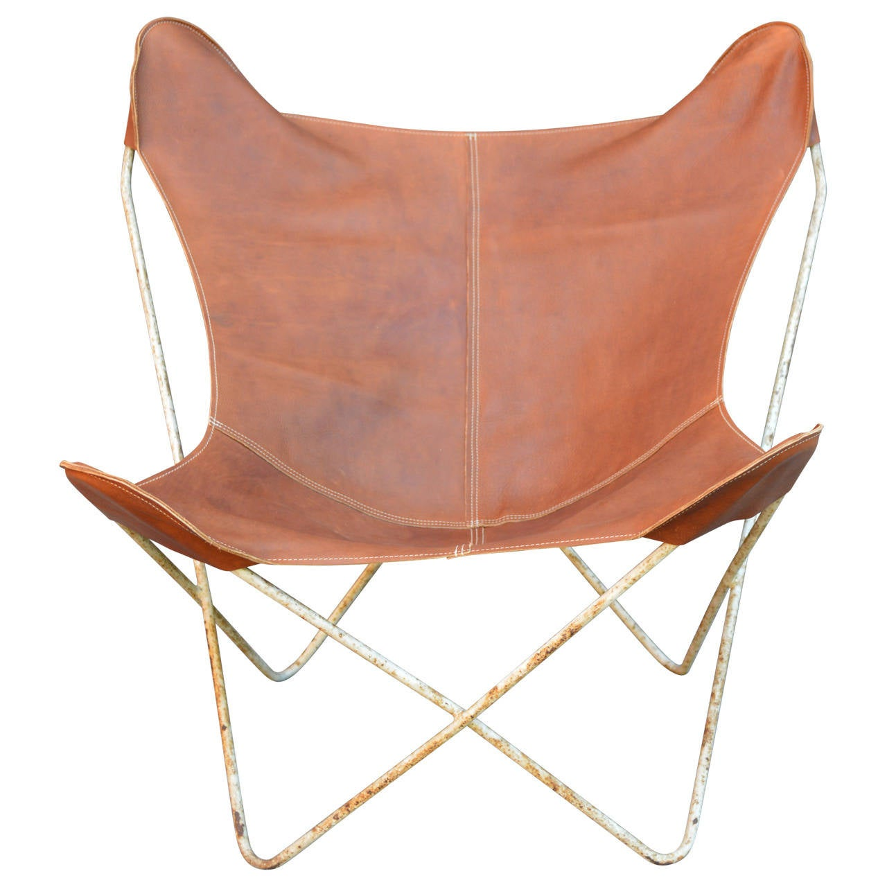Great vintage butterfly chair frame with removable rustic chestnut brown leather cover.