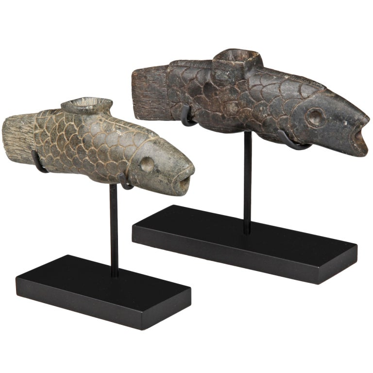 Pair of native american carved stone fish form pipes at