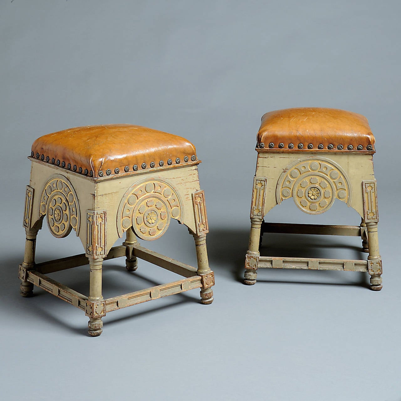 an unusual pair of grey-painted parcel-gilt stools, original decoration, probably American, circa 1880.