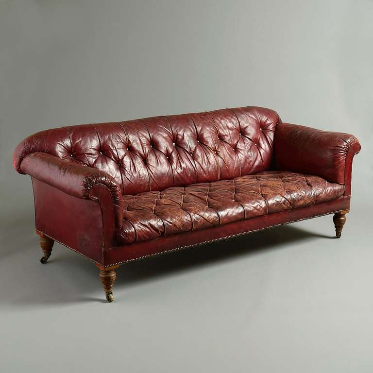 A Fine Victorian Walnut Sofa With Original Oned Red Morocco Leather Upholstery Circa 1880