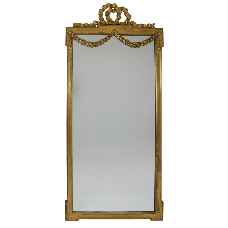 large italian gilt mirror with ribbon and garland details