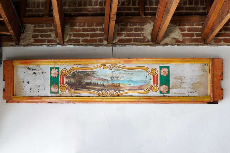 This hand painted panel from a carousel ride is a rare architectural salvage. Repurposed as wall art, it is a gem. One-of-kind.
