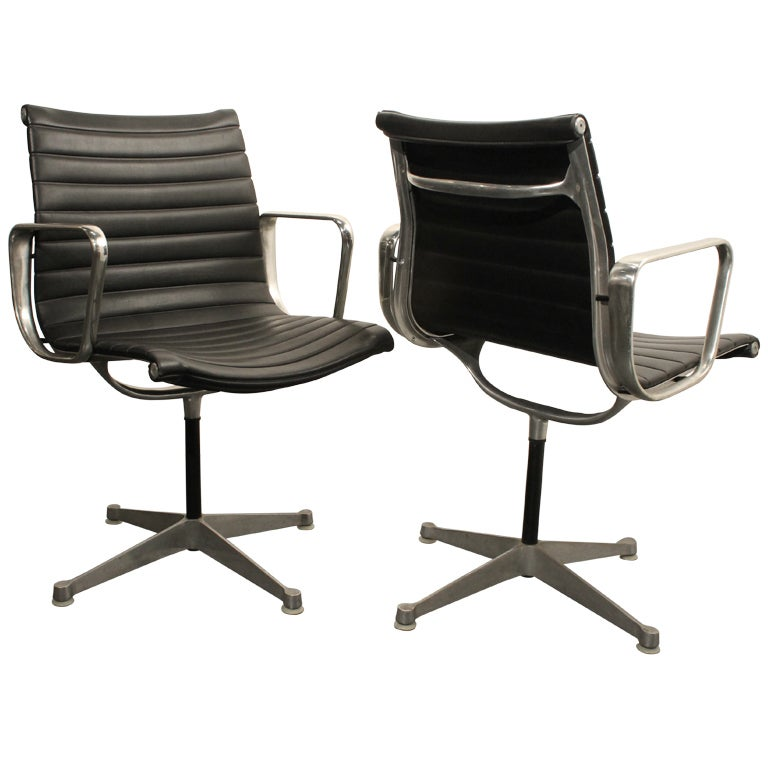 pair of early eames aluminum group executive chairs at 1stdibs