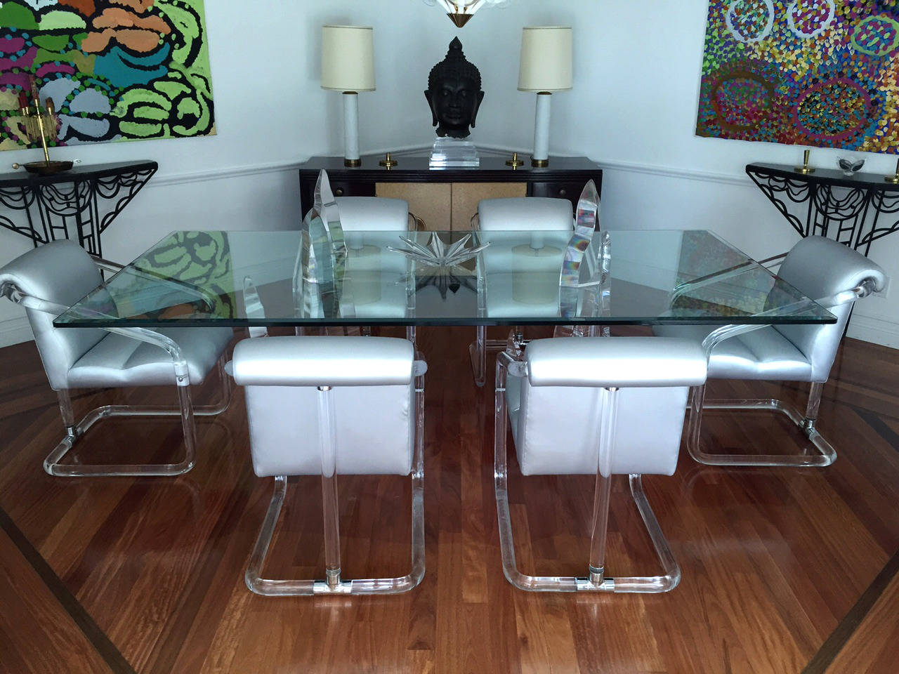 A glamours set of six dining chair with low arm designed by Lion in Frost, circa 1970s. These chairs have solid Lucite tubular frames joined by chrome T-shape hardware. The elements render them gorgeous from all angles. They have been newly