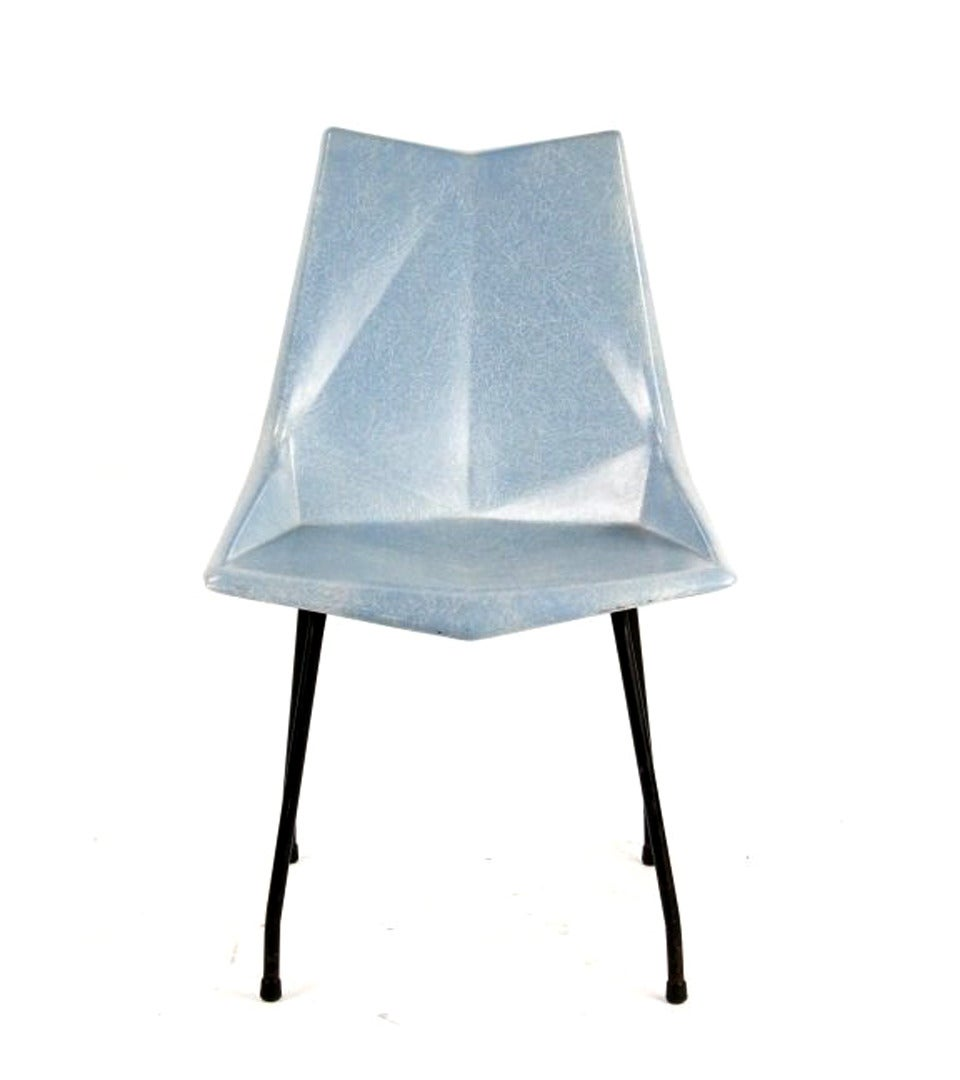 A rare design by Paul McCobb (American, 1917-1969) for St. John, circa 1950s, this all original Origami Chair if made of a light blue fiberglass seat and black iron rod frame. The seat was molded at angles reminiscent of a Japanese origami. Still