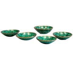 Set of five natural malachite and bronze bowls