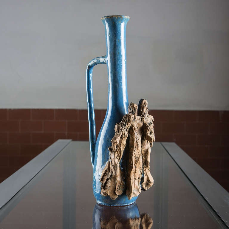 Beautiful ceramic bottle with sculpture by Renato Bassoli.  Biographic notes: He was born in Milan, where from 1937 to 1948 he attended the Brera Academy and the