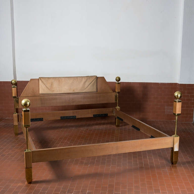 Rare Italian kingsize bed in massive wood and brass elements. Removable fabric panel on the front and beautiful details.