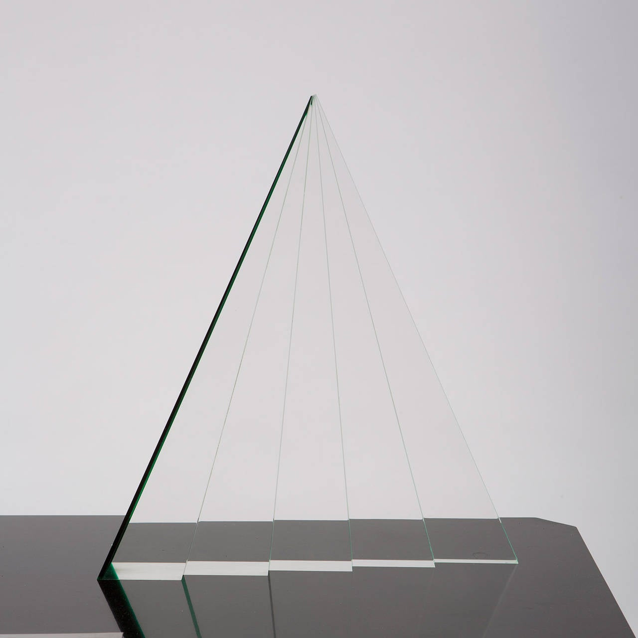 Plexiglas sculpture by Luca Bonato for Fusina. The piece, visually composed by five triangular layers, fully represent the beauty of the material that can be underlined or totally disappear turning the piece. The massive plexiglas piece is signed