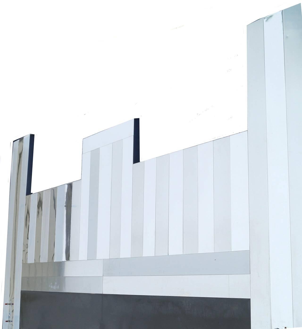 Paul Evans cityscape king-size bed headboard.
