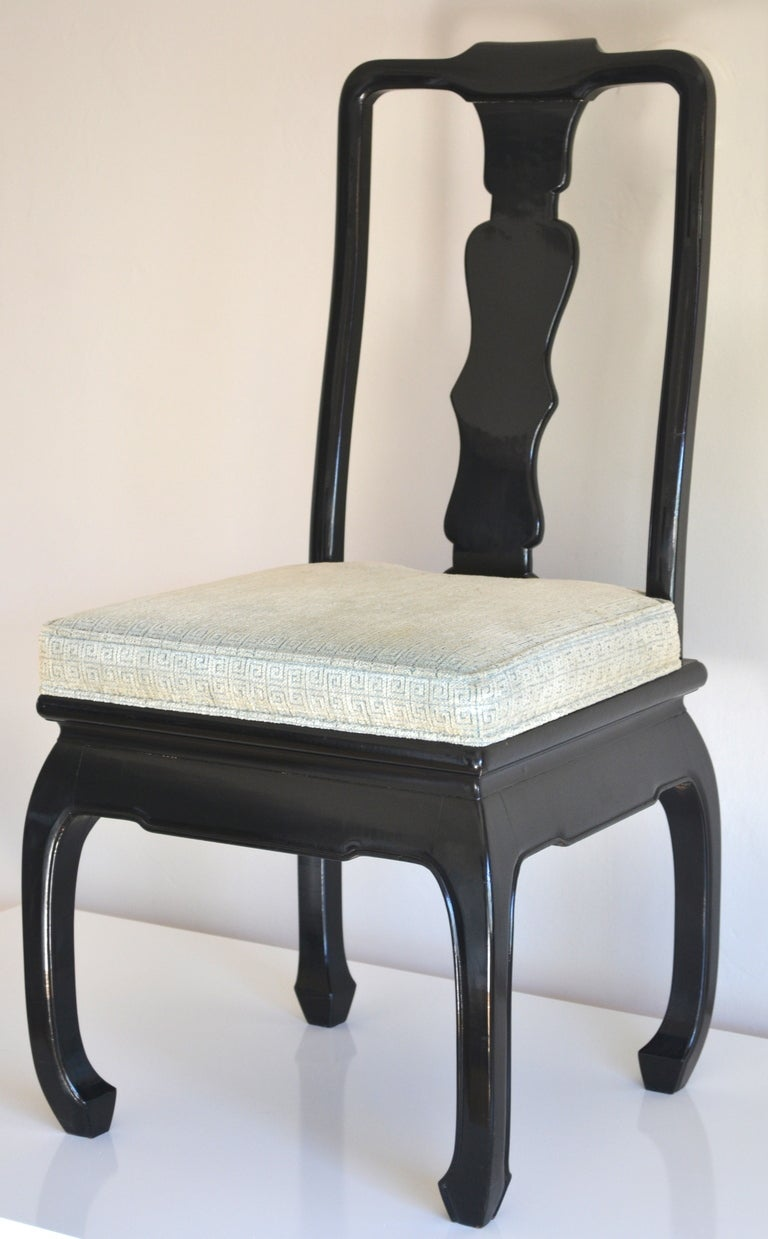 Incredible set of 8 Hollywood Regency style ebonized dining chairs.  These exquisite black lacquered dining chairs styled in the manner of James Mont are upholstered in the original embossed Greek key motif celadon cotton velvet fabric, c. 1950s -