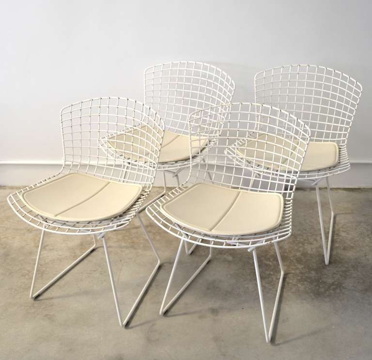 Superbe Set Of Four Architectural Welded Mesh White Powder Coated Dining Chairs  With White Vinyl Seat Cushions