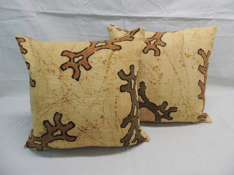 Antique Textiles Galleries: Pair of vintage Yellow and Brown African mud cloth decorative pillows, depicting tribal designs in shades of brown, deep yellows. Cotton backings.  Boho-chic style accent pillows.  Decorative pillows handcrafted and