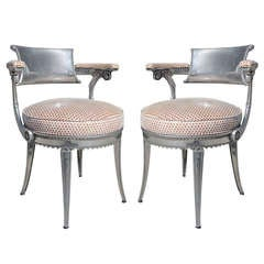 A Pair of Cast Aluminum Cafe Chairs in Perforated Patent Leather