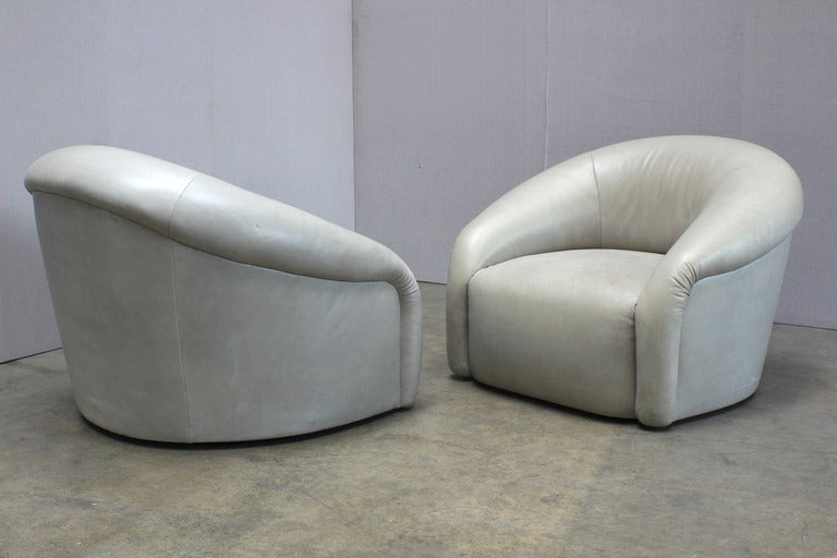 A Pair of 1970s Barrel Back Swivel Club Chairs at 1stdibs