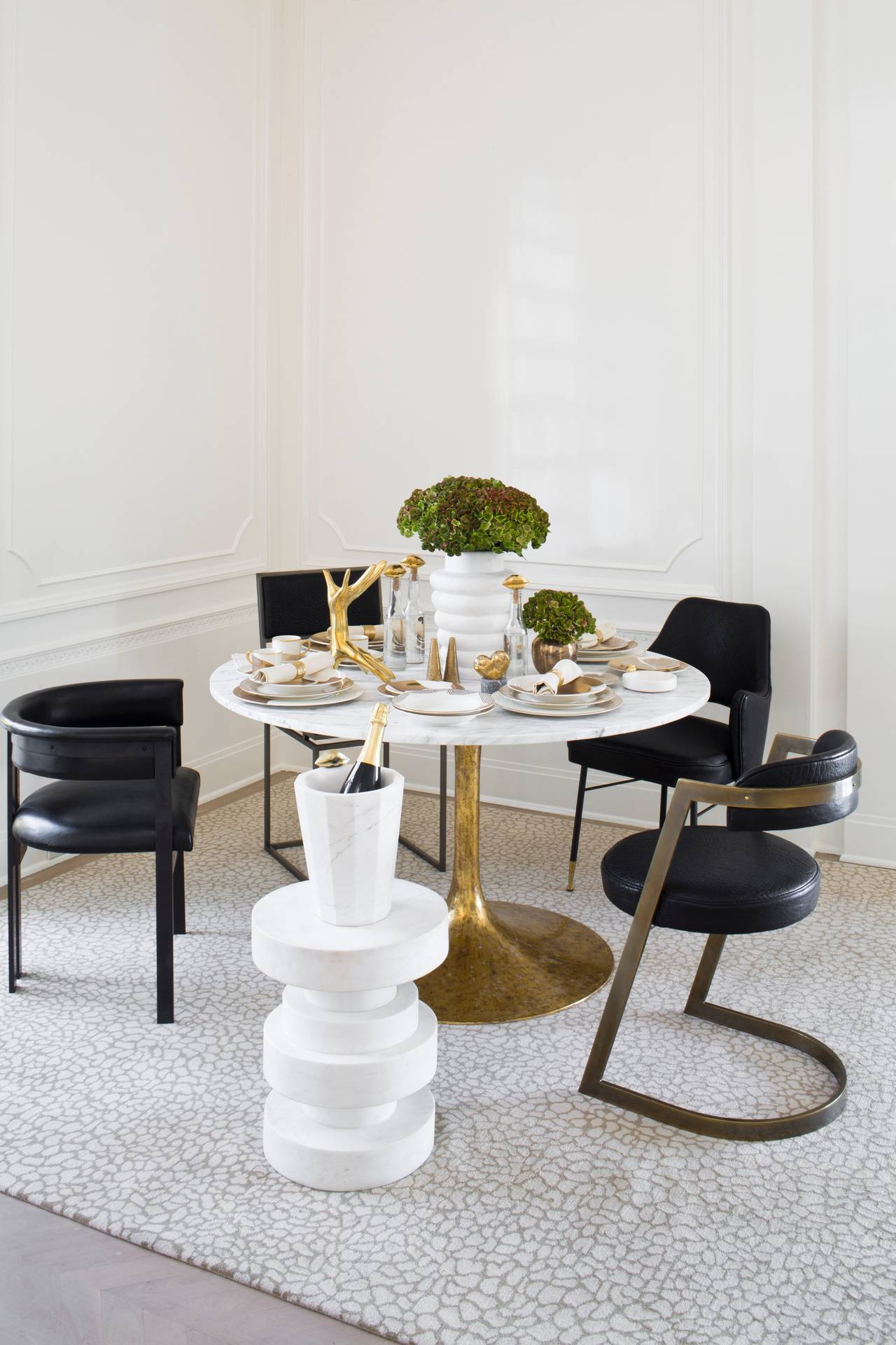 A glamorous mix of bronze and leather, the studio chair's curves and edges create a distinctive, elegant form. The rounded back maximizes comfort while keeping proportions petite.  The studio chair is available in burnished bronze, natural bronze,