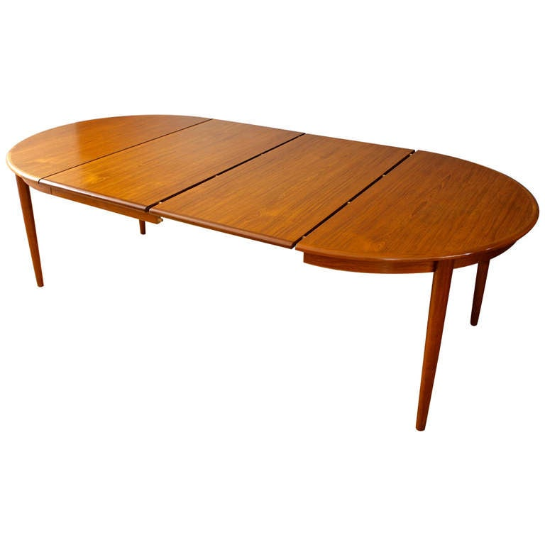 Danish modern dining table with leaves by kai kristiansen for Danish modern dining room table