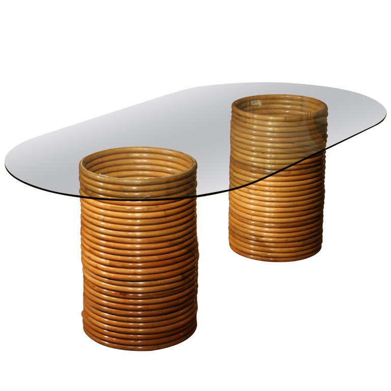 Stacked Rattan Dining Table With Oval Glass Top In The
