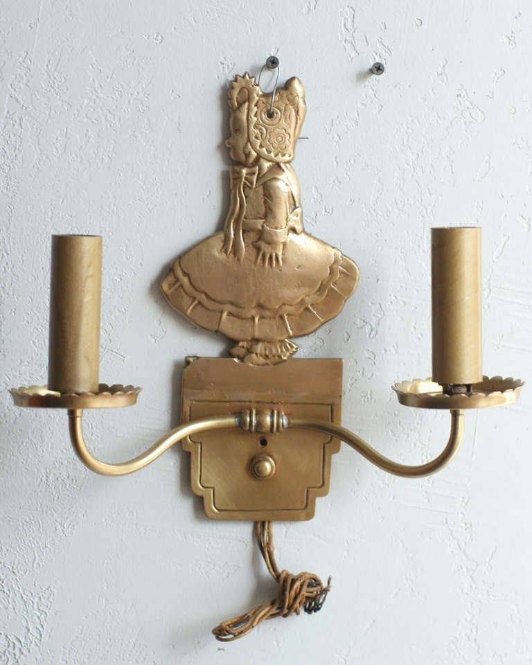 bronze electric candelabra wall sconce with girl in bonnet