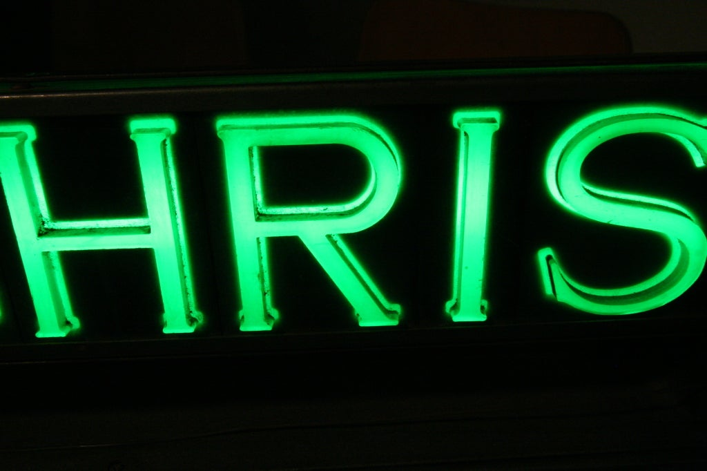 This cheerful post war enameled steel sign features light up plastic letters with