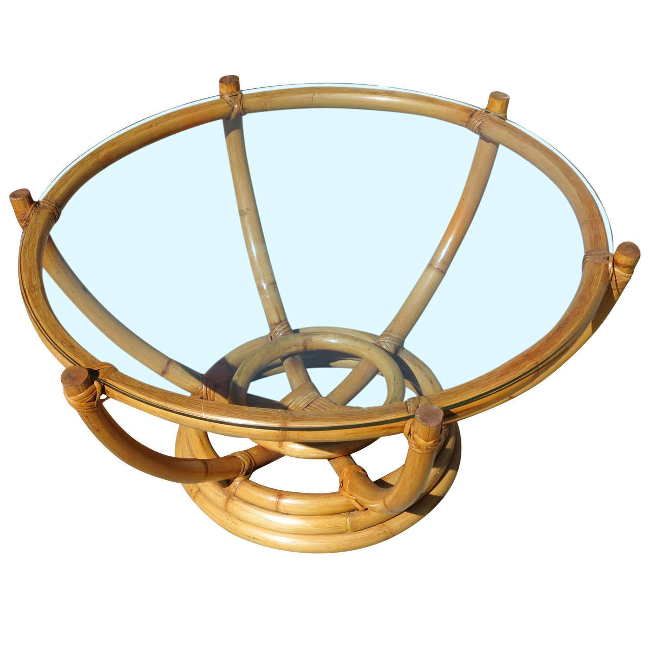 restored six pole rattan coffee table with floating glass top for