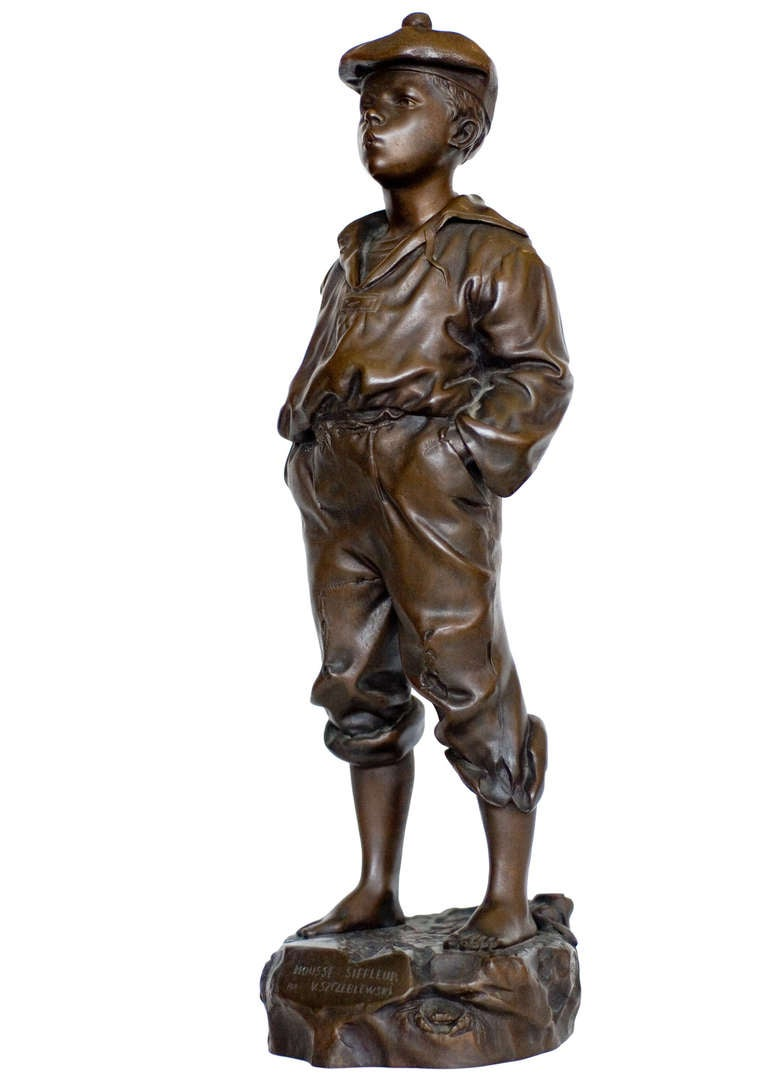 A Cast Bronze Sculpture Of Young Barefoot Boy The Stands Nonchalantly With His