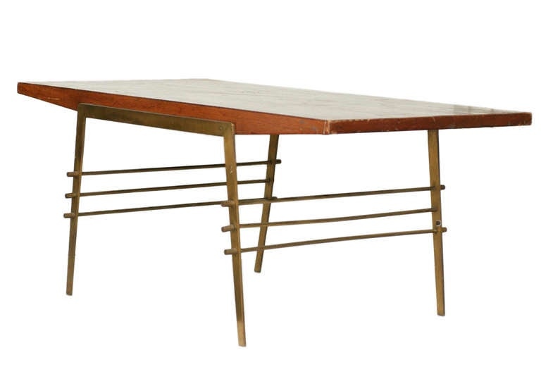 Mid-Century wood coffee table with brass architectural base.