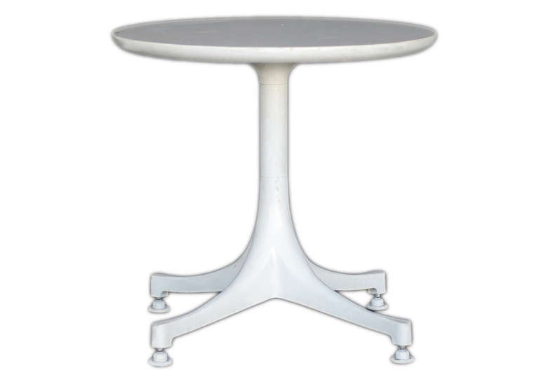 The pedestal table designed by George Nelson for Herman Miller was offered in a range of sizes and heights to serve as either a coffee table or end/ side table. The bases were available in either polished or painted aluminum and the tops in black or