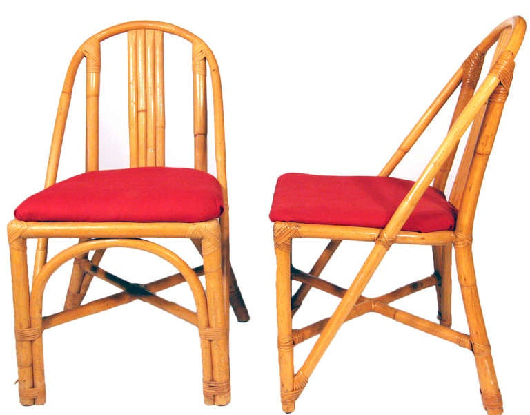 Vintage slat leg rattan dining room chair, included is a set of four chairs. Designed in the manner of Paul Frankl. Other styles and quantities available.  Cushions made to order included. The cushions pictured in these photos are for display use